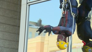 Putting trust into ropes as risk-takers rappel off of Regina tower